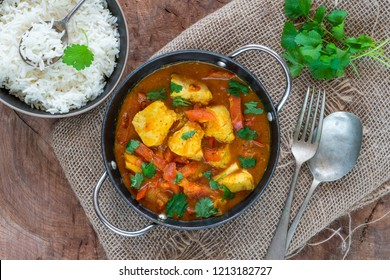 Fish Mappas - Keralan style coconut fish curry with rice. It's a popular dish in southern Indian state of Kerala. Top view
