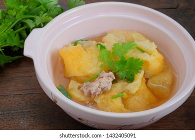 Fish Maw Soup On Wooden Table And Vegetable Background