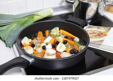fish meal with vegetables in a skillet