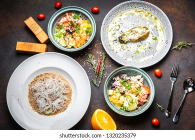 Fish and meat meals variety flat lay. Top view on buffet with assortment of healthy hearty food. Buffet, banquet, appetizer, restaurant menu concept