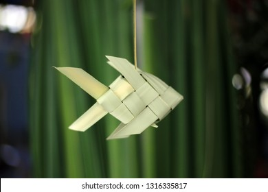 The fish mobile was made from weaving of the palm leaf. Thai traditional hand craft palm leaf fish mobile.