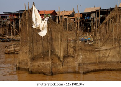 Fish nets and traps and Stilt houses during dry season at the Kompong Kleang floating fishing village,  Cambodia