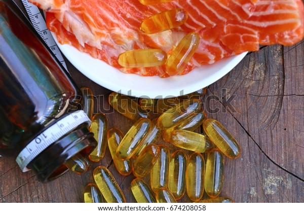 fish oil capsules with fresh fish