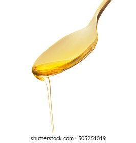 Fish oil dripping from spoon isolated on white, close up view