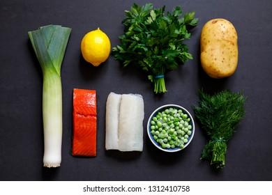 Fish pie ingredients on black background