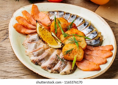 Fish plate with herring, mackerel and salmon. Assorted fish on a plate