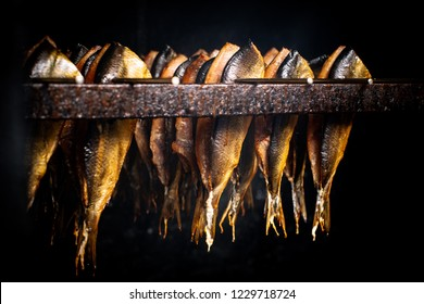 Fish processing plant. Fish of cold (hot) smoked. Smoked Fish In Smokehouse Box.  Close Up Smoking Process Fish For Home Use. Preparation Of Organic Food.