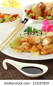 Fish with rice, salad and dark soy sauce