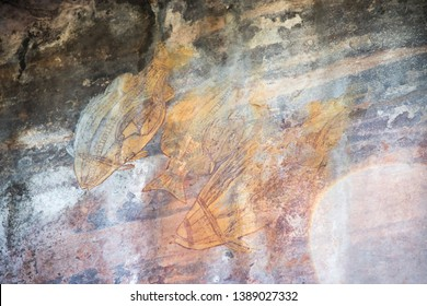 Fish rock art with ochre colour in Ubirr on the rugged rock shelters in the Kakadu National Park in Australia