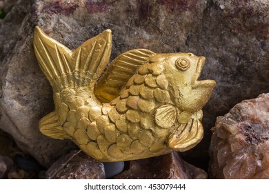 Fish sculpture on the rocks,made with baked clay