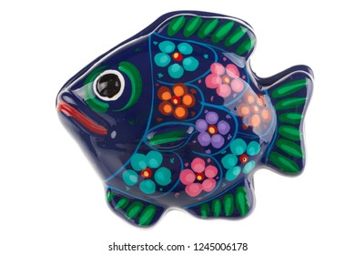 a fish shaped ceramic box isolated over a white background