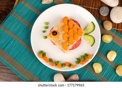 A fish shaped sandwich, healthy kid food