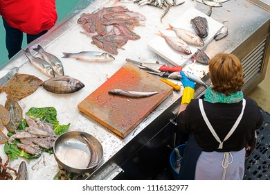 fish shop in supermarket and fishwife