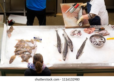 fish shop in supermarket and woman buying