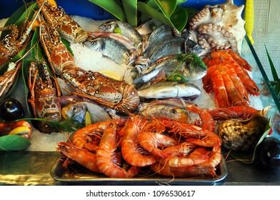 Fish, shrimp, crabs on ice.