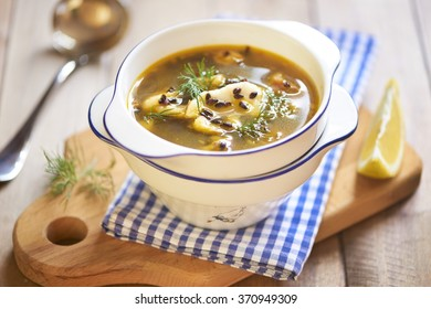 Fish soup with black rice