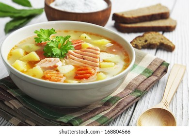 Fish soup in a bowl on the table