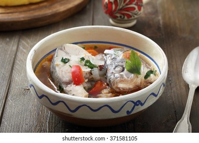 fish soup in ceramic bowl rustic kitchen table background