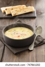 fish soup on black background