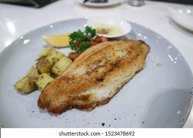 fish steak , catfish steak with white cream sauce and vegetable