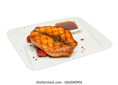 Fish Steak on White Plate Isolated. Grill Salmon Fish with Vegetable and Sauce. Gourmet Restaurant Food