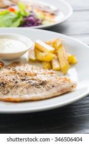 fish steak on wood table