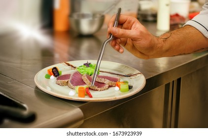 fish steaks cooked with vegetables prepared by a cook