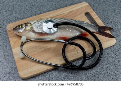 Fish and stethoscope. The danger of eating. Or diet food.