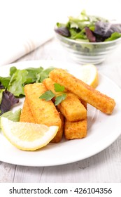 fish sticks with lemon and salad