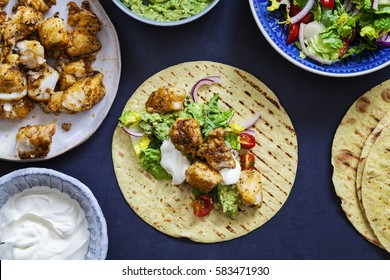 Fish tacos with spicy cod, salad and homemade guacamole