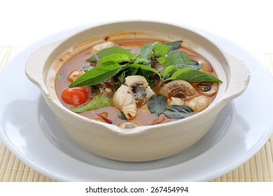 fish tom yum served in a clay pot, thai food
