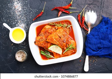 fish with tomato sauce and aroma spices, stock photo