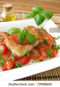 Fish with tomatoes and basil