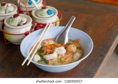 Fish Tomyum noodle on wood table