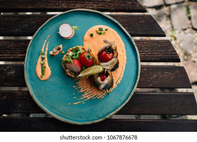 fish with vegetables and sauce, fine dining
