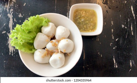 Fishball in white bowl with sauce