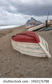 Fishboats on the beach of La Linea on the Rock of Gibraltar background, Spain.
