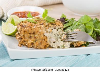 Fishcake - Deep-fried tuna, lime and coriander fishcake served with salad.