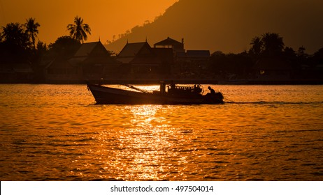 Fisher boat returning home at sunset, Kampot, Cambodia