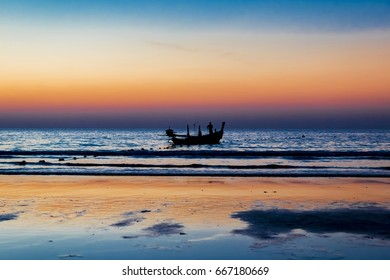 Fisher boat in sunset