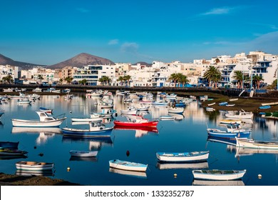 Fisher boats at the laguna Charco de San Gines at sunrise, city of Arrecife, Lanzarote, Canary Islands
