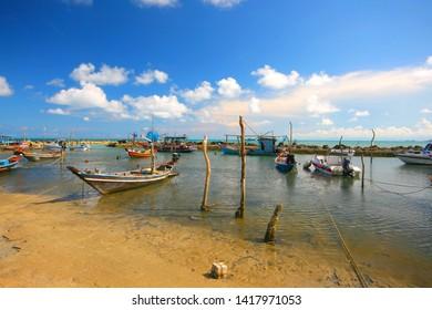Fisher boats in the water near the beach  sunshine Samui Thailand