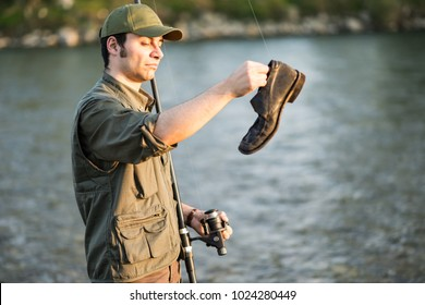 Fisher fishing an old shoe