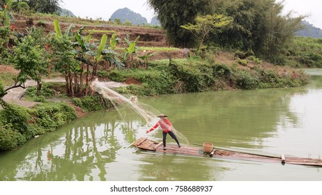 Fisher fishing on a lake in a village.