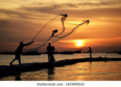 fisher man net with sunset in the sea