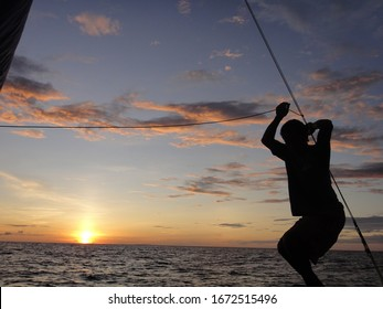 Fisher on a sailing boat