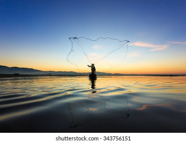 Fisherman in action when fishing, Thailand