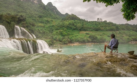 fisherman at ban jock waterfall vietnam