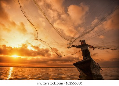Fisherman of Bangpra Lake in action when fishing, Thailand