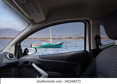 Fisherman boat at ancor viewed from inside a car